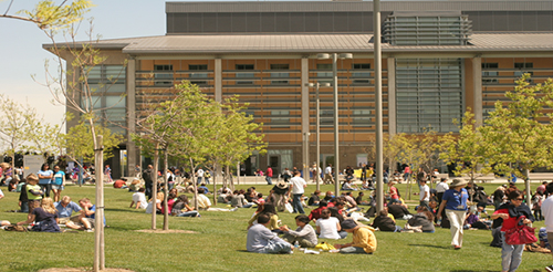 UC Merced students sitting outside enjoying the weather
